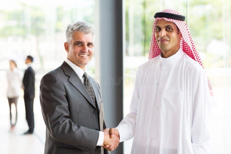 Senior businessman Arabian partner royalty free stock images