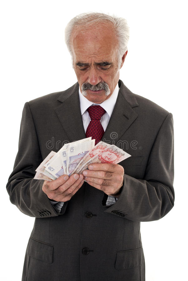 Senior businessman counting money royalty free stock photography