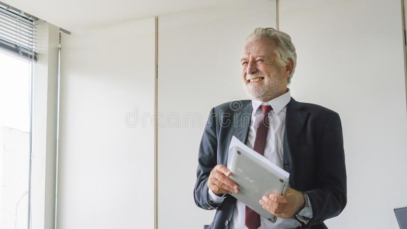 the Senior businessman happy about his great business deal. stock photos