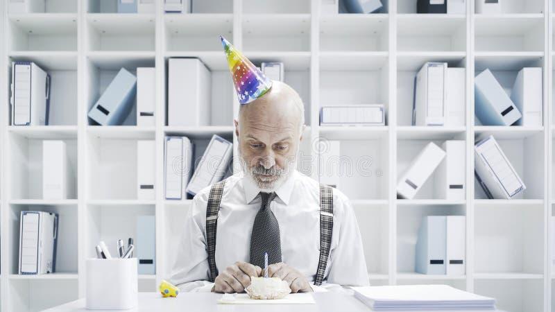 Senior businessman having a sad lonely birthday stock images