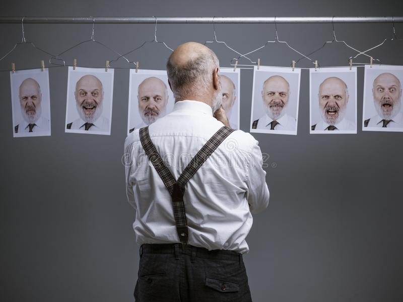 Senior businessman and his multiple expressions and personalities stock image