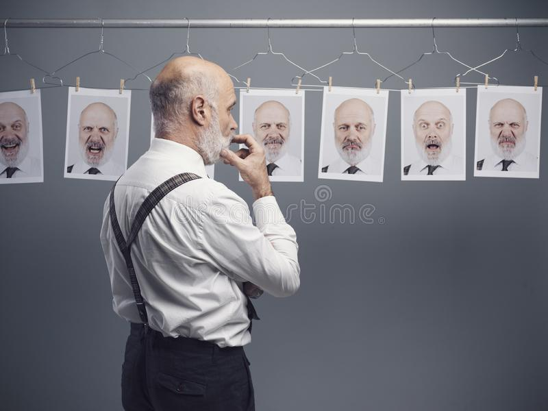 Senior businessman and his multiple personalities stock images