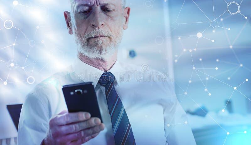 Senior businessman holding his mobile phone; multiple exposure. Senior businessman holding his mobile phone at office; multiple exposure royalty free stock photos
