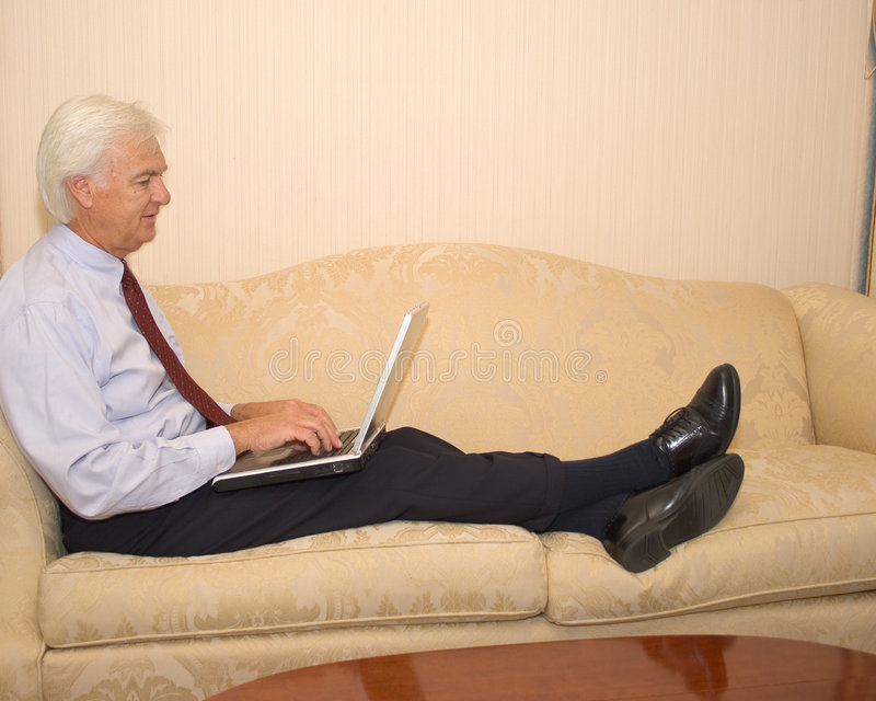 Senior Businessman on Laptop stock photography