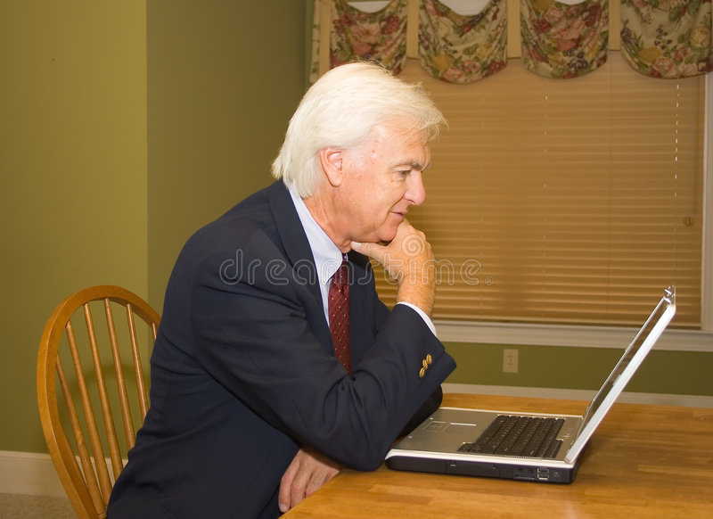 Senior Businessman on Laptop royalty free stock photos