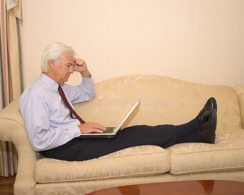 Senior Businessman on Laptop royalty free stock photo