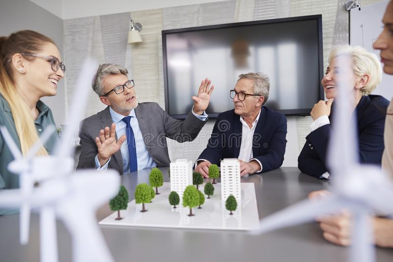 Senior businessman leading during conference stock photo