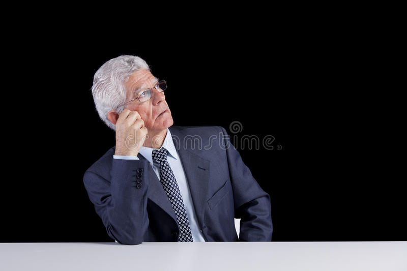 Senior businessman looking up royalty free stock image