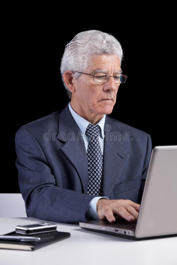 Senior businessman at the office stock images