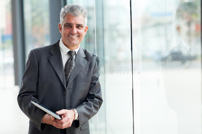 Senior businessman office window royalty free stock images