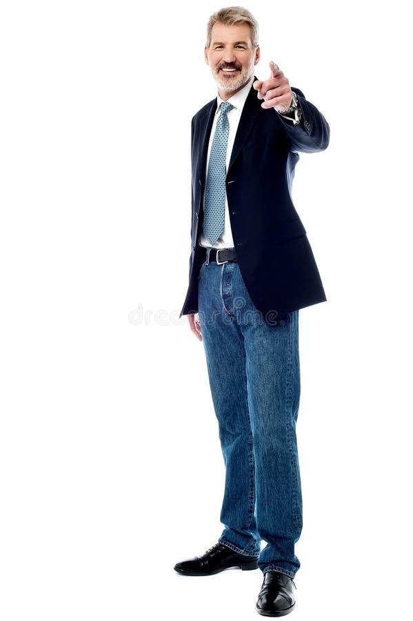 Senior businessman pointing to front stock photos