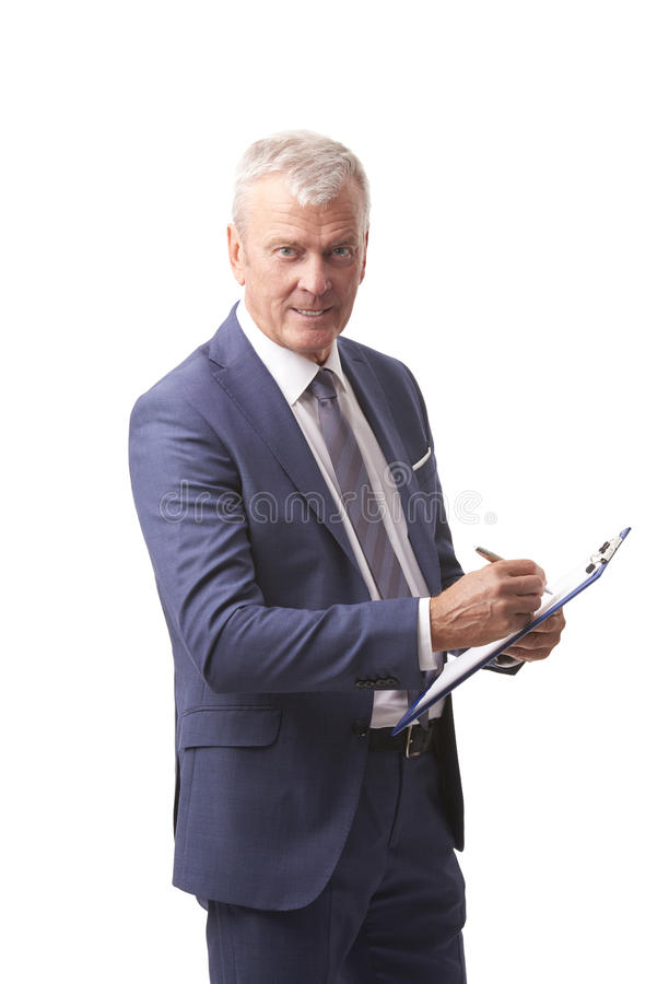 Senior businessman portrait. Shot of a senior account manager holding clipboard in his hand while standing at isolated white backround stock photography
