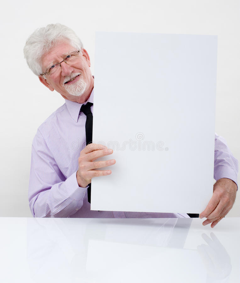 Senior businessman and sign royalty free stock images