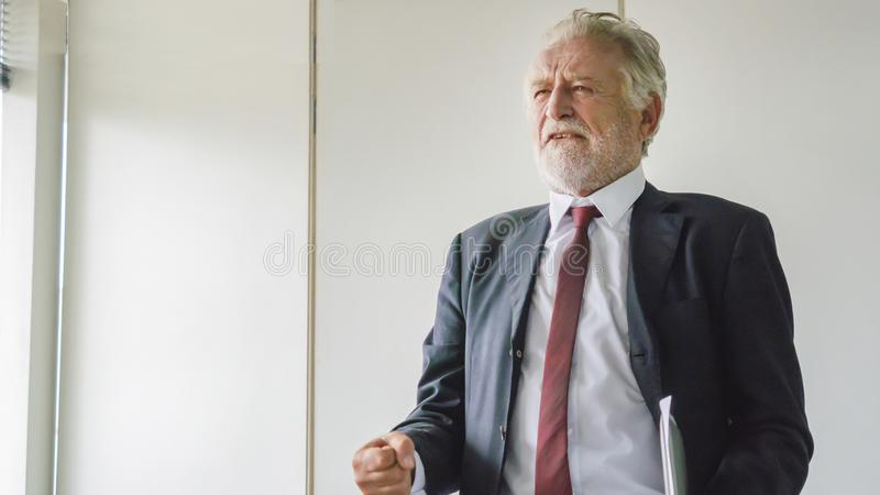 The Senior businessman in smart suit feeling depressed royalty free stock photos