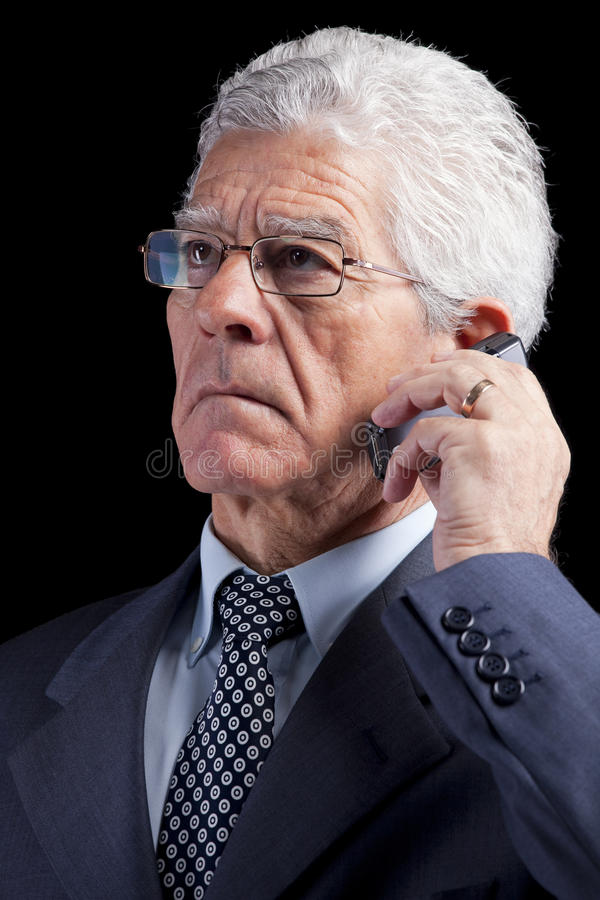 Senior Businessman talking at the cellphone royalty free stock photos