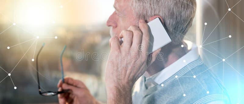 Senior businessman talking on mobile phone, light effect, overlayed with network. Senior businessman talking on mobile phone and looking through the window stock photos