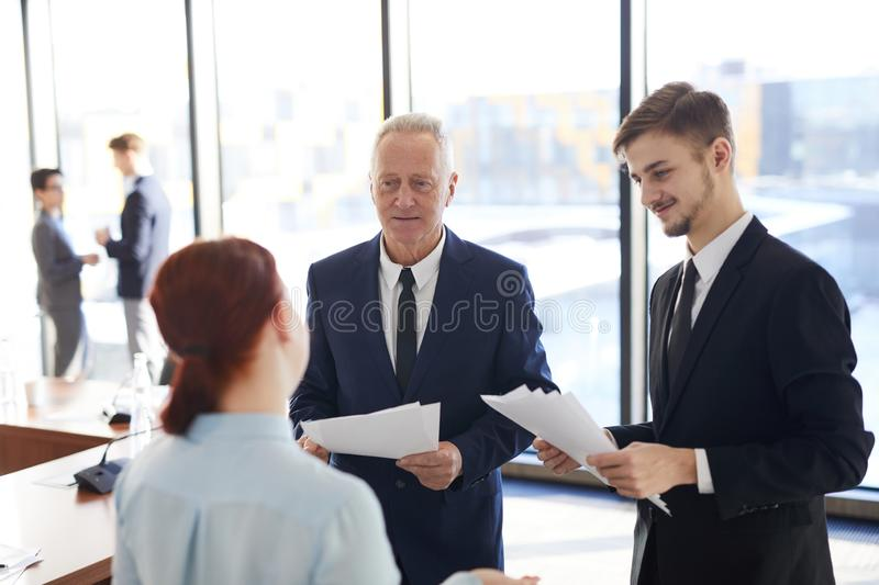 Senior Businessman Talking to Employees royalty free stock images