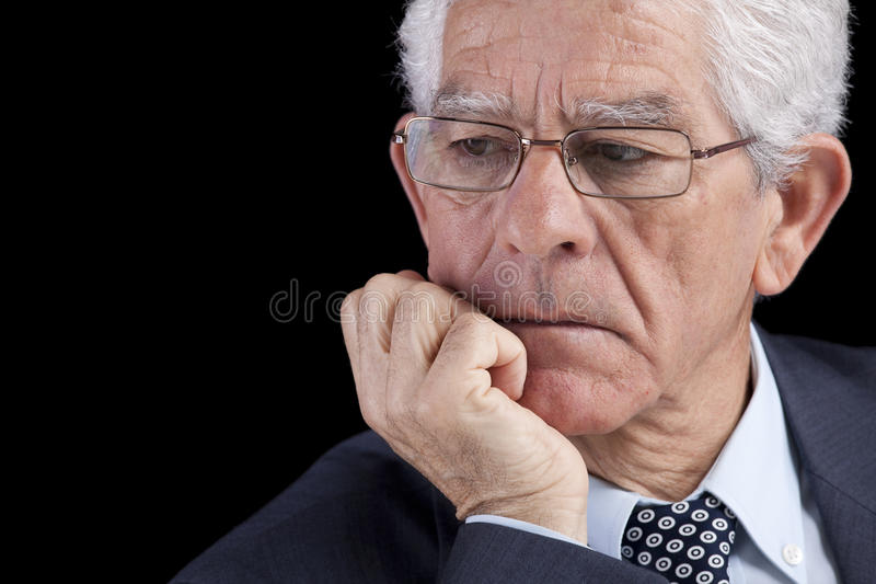 Senior businessman thinking stock photography