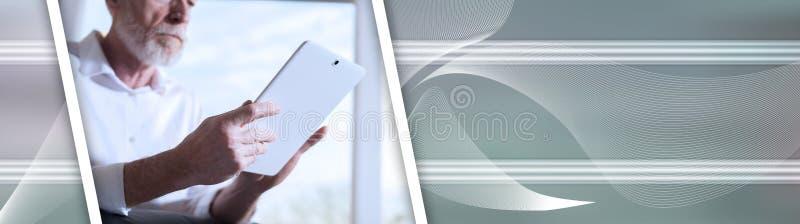 Senior businessman using a digital tablet, hard light; panoramic banner. Senior businessman using a digital tablet in office, hard light; panoramic banner stock photography