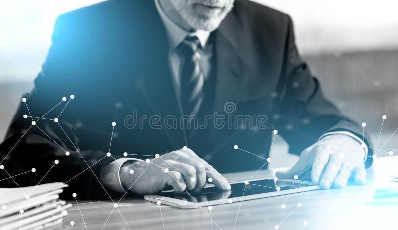 Senior businessman using a digital tablet. In office stock photos