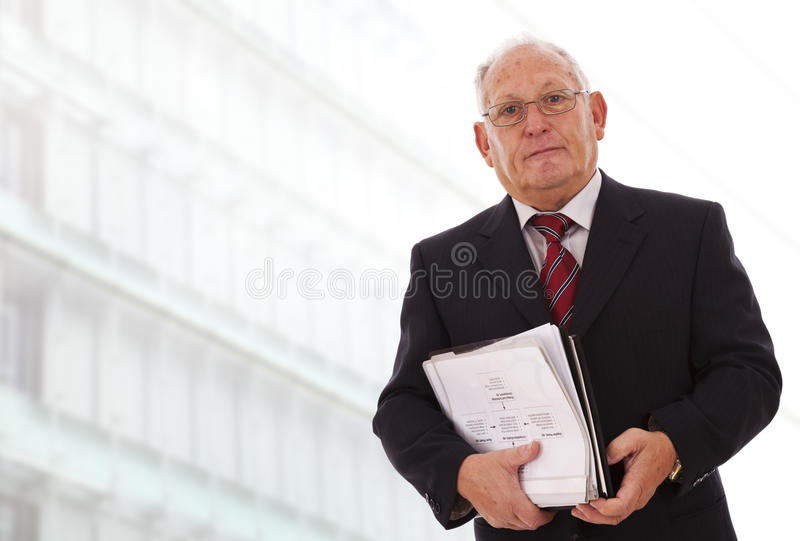 Senior businessman working stock photography