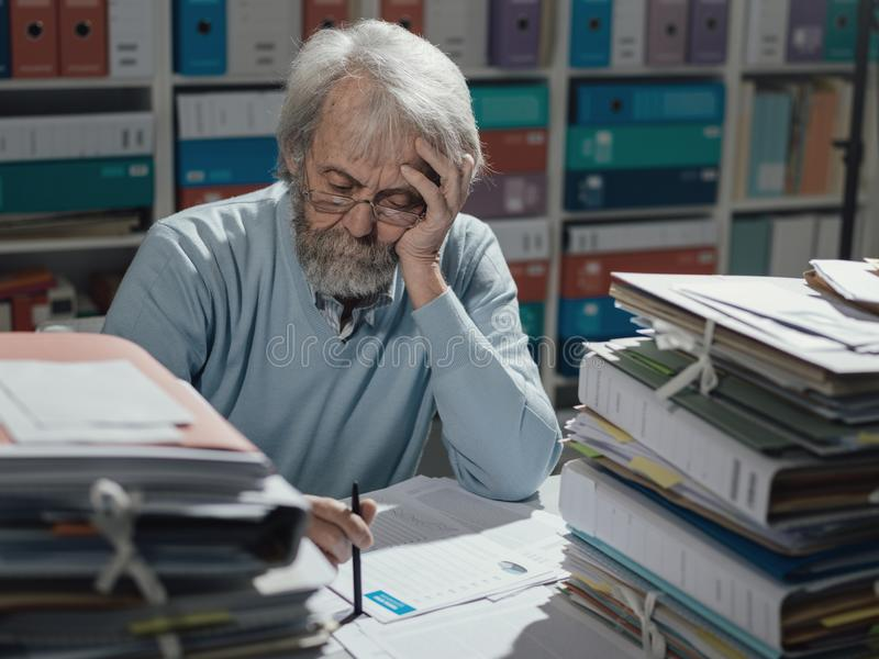 Senior businessman working in the office stock image