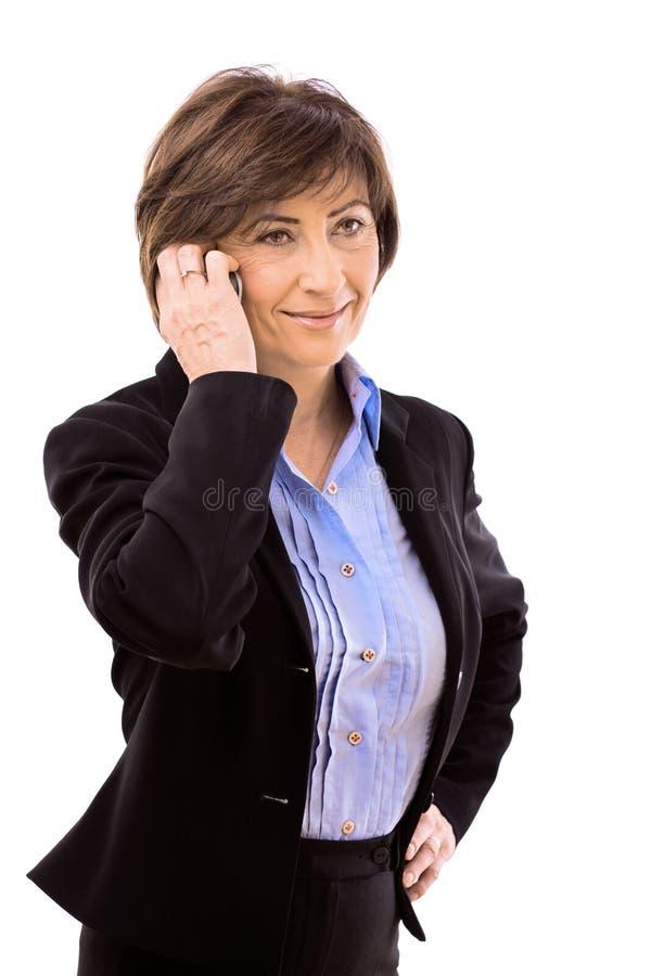 Senior businesswoman calling on phone stock photos