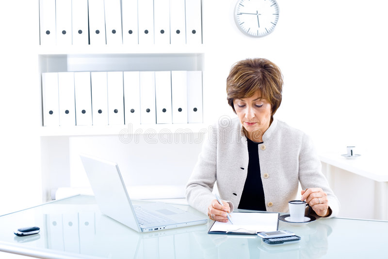 Senior businesswoman in office stock photography