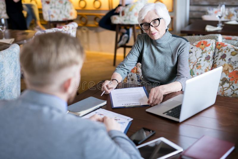 Senior businesswoman signing a contract royalty free stock image