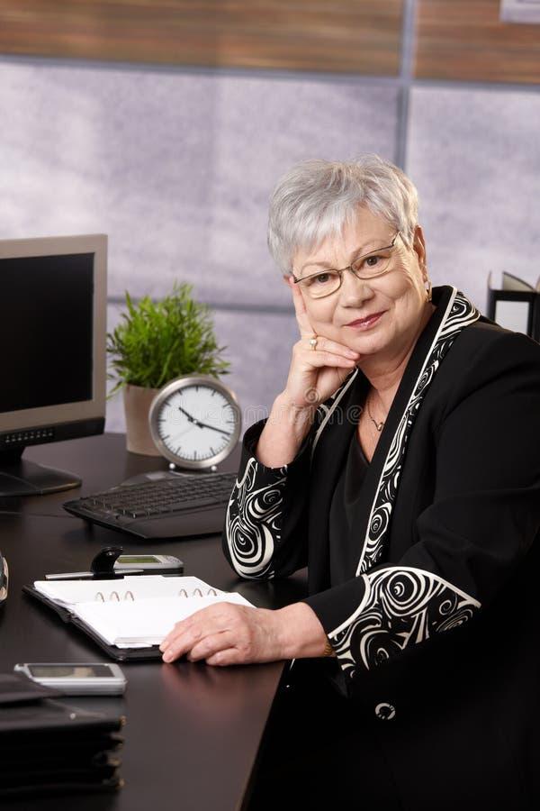 Senior businesswoman sitting in office