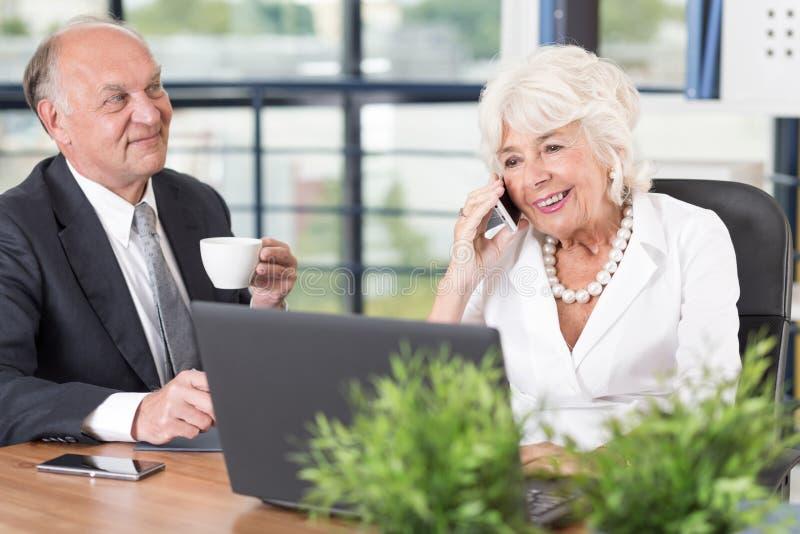 Senior businesswoman talking on mobilephone. Picture of smiling senior businesswoman talking on mobilphone royalty free stock photos
