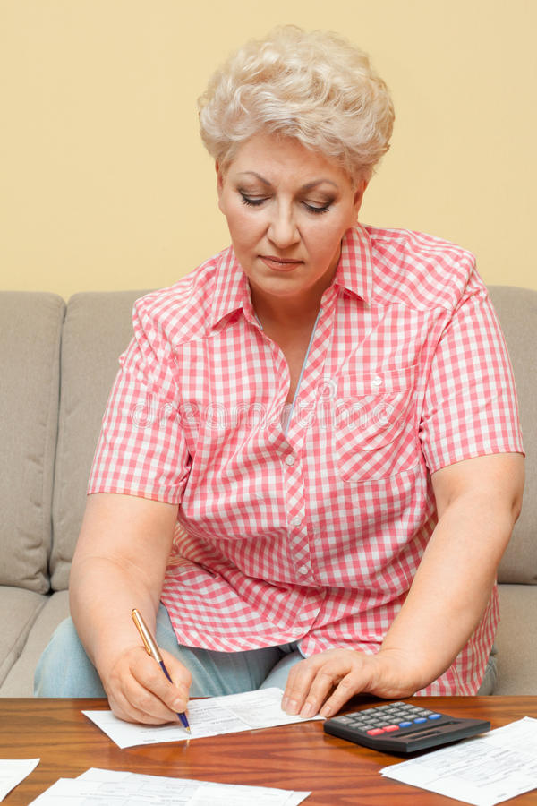 Download Senior Calculating Her Debts And Write Stock Image - Image: 30373001