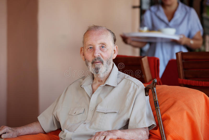 Senior with carer royalty free stock image