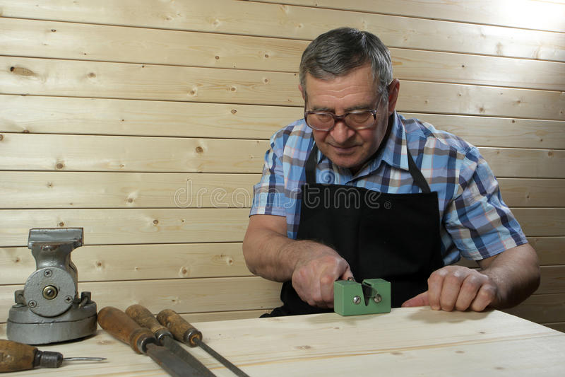 Senior carpenter working in his workshop. Senior carpenter working in workshop stock photos