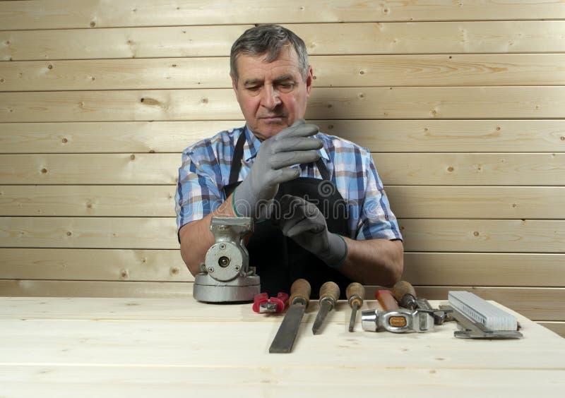 Senior carpenter working in his workshop. Senior carpenter working in workshop royalty free stock photos