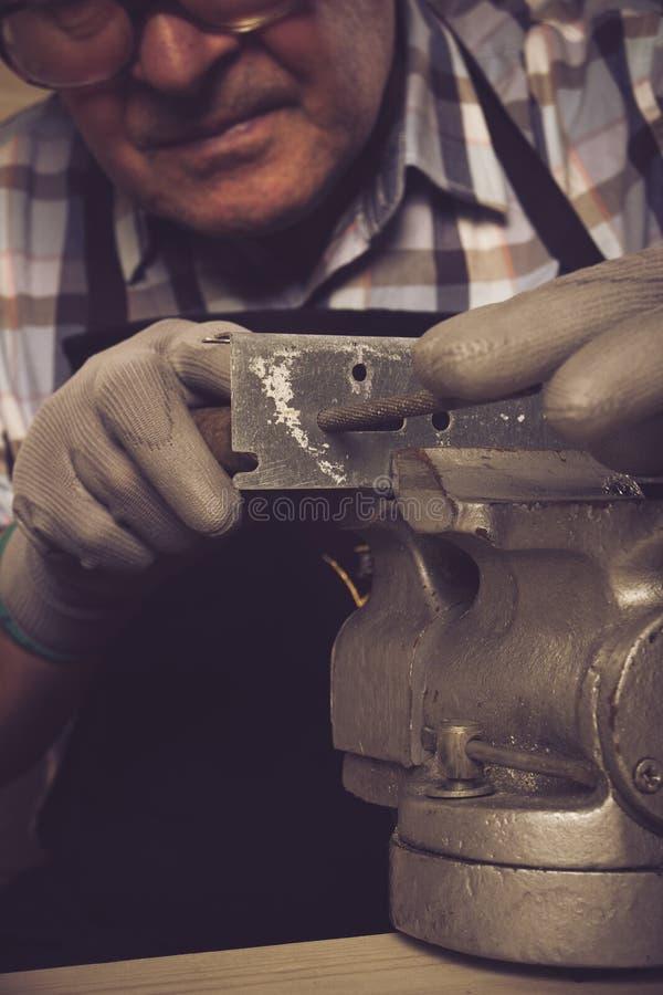 Senior carpenter working in his workshop. Senior carpenter working in workshop stock photography