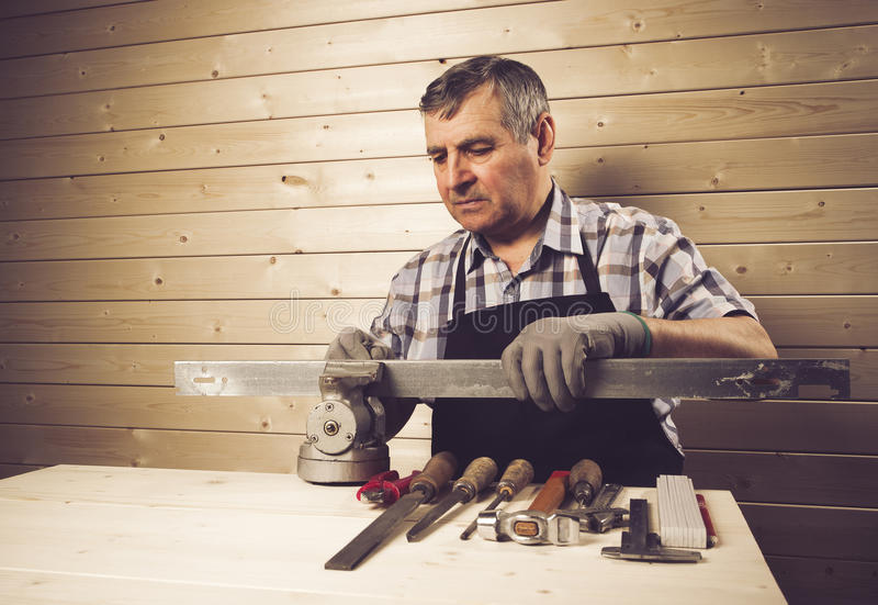 Senior carpenter working in his workshop stock photos