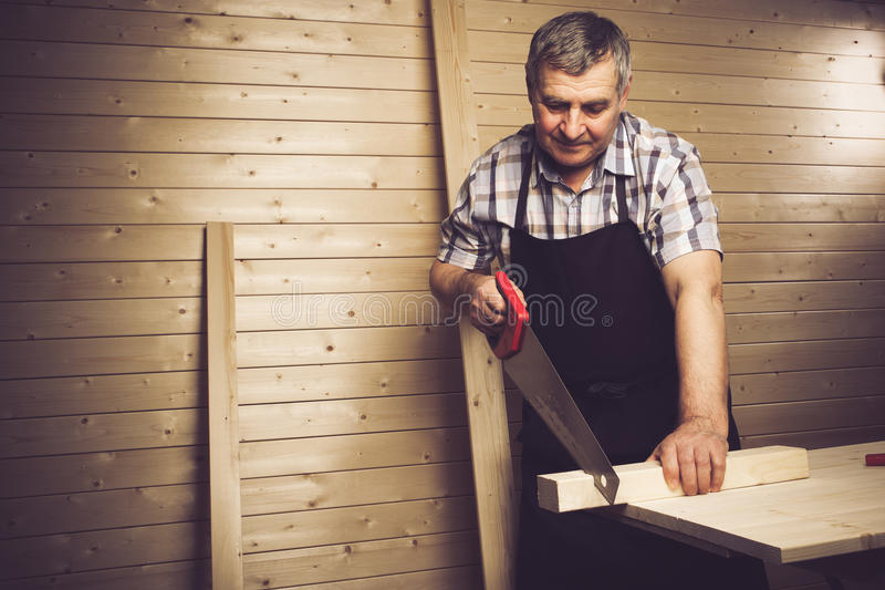 Senior carpenter working in his workshop stock photo