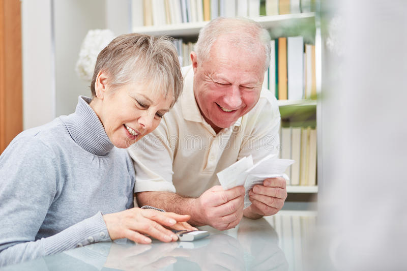 Senior with cash book and receipts royalty free stock images