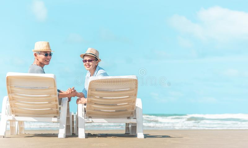 Senior caucasian couple sitting on bench near the sea and hugging. Horizontal shape, rear view, copy space.  royalty free stock photo