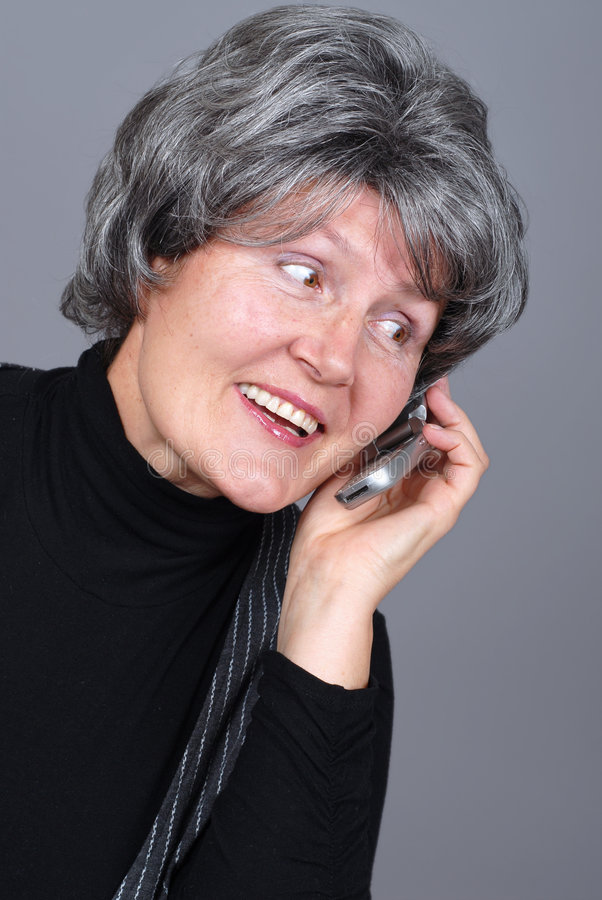 Senior with a cell phone royalty free stock images