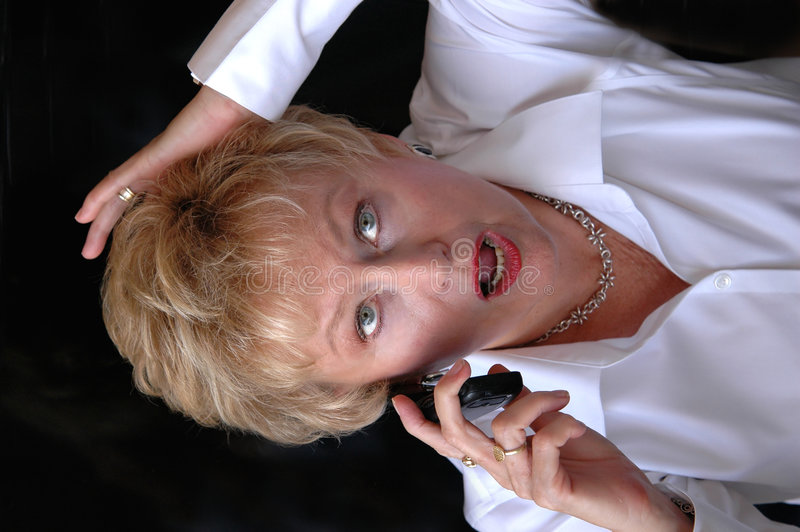 Senior On Cell Phone Surprised Stock Image