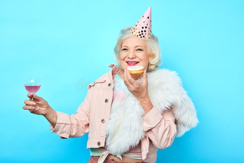 Senior charming woman having fun on her Birthday stock image