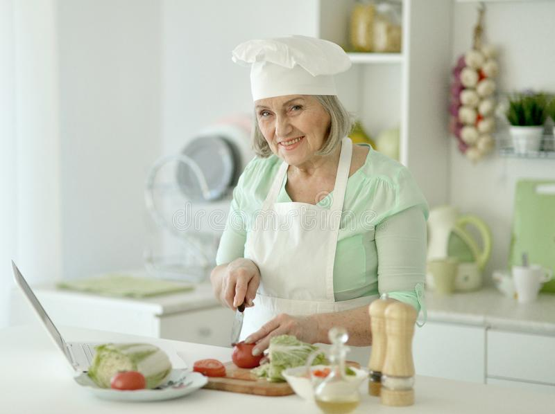 Senior chef woman portrait at kitchen royalty free stock photo
