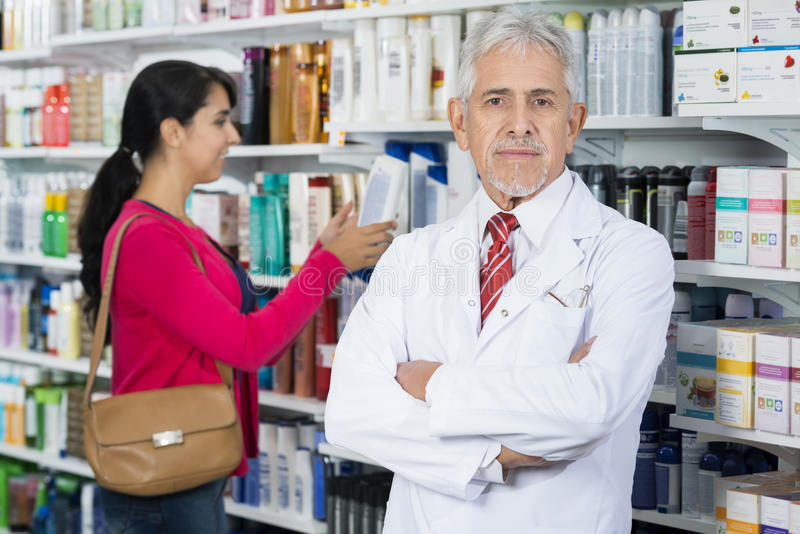 Senior Chemist Standing Arms Crossed While Customer Choosing Pro royalty free stock images