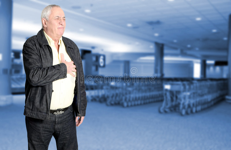 Senior with chest pain royalty free stock photography