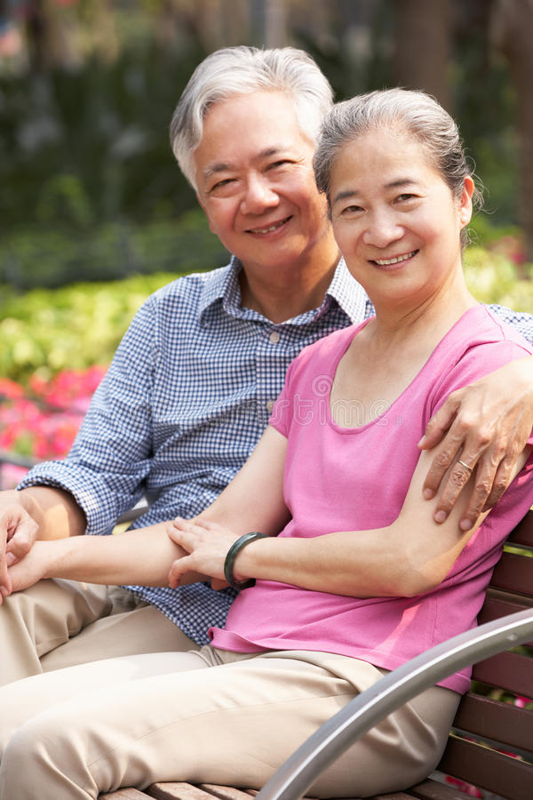 Download Senior Chinese Couple Relaxing On Park Bench Stock Image - Image of person, affectionate: 26098607