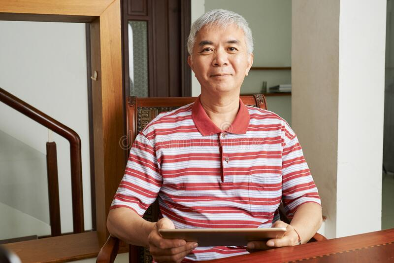 Senior Chinese man with tablet computer royalty free stock photo