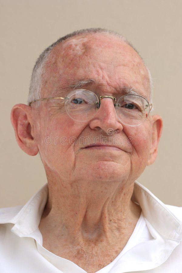 Senior citizen. Portrait of a senior man looking at the camera royalty free stock photo