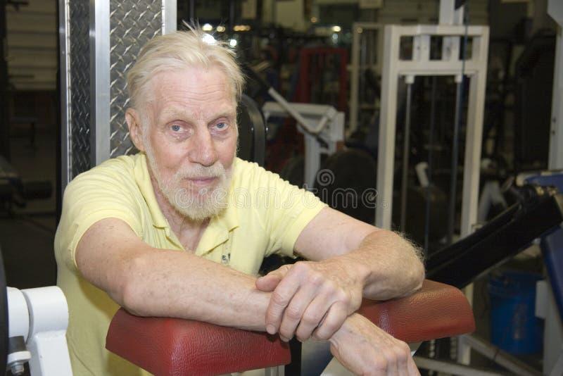 Senior citizen at gym royalty free stock image